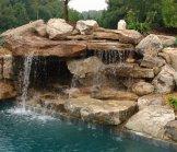 Creative Garden Spaces Inc, pool waterfall, natural waterfall, custom stonework