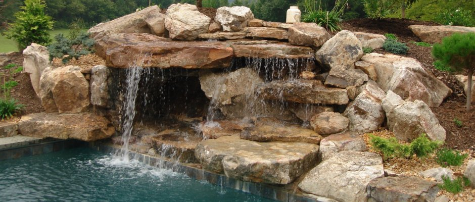 Creative Garden Spaces Inc, pool waterfall, natural waterfall, custom stonework