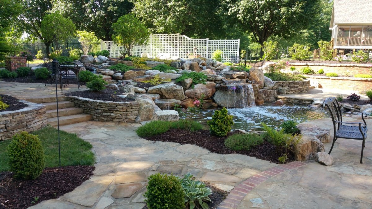 Creative Garden Spaces Inc, Danville VA, water feature, natural waterfall, water garden, koi pond, creative landscape, natural hardscape, custom stonework, stone patio, stone steps, stone walls, flagstone, groundcovers, landscape boulders