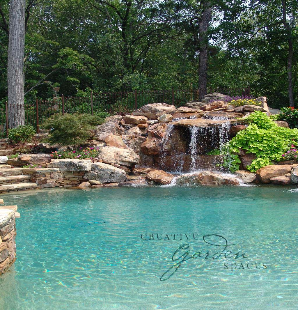 Creative Garden Spaces Inc, Winston-Salem NC, pool waterfall, natural waterfall, water feature, pool fountain, landscape boulders, custom stonework