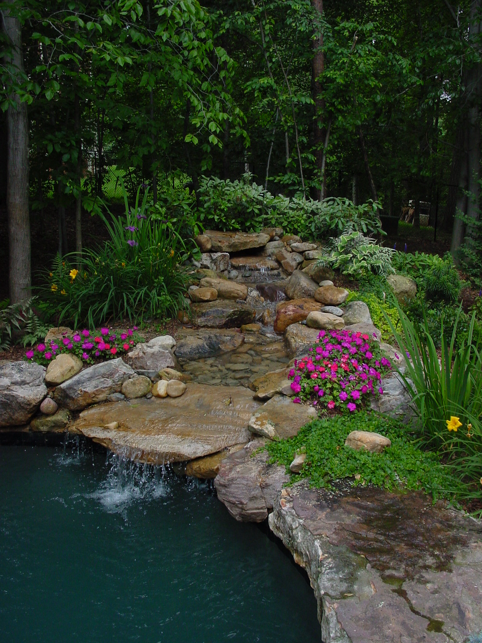 Creative Garden Spaces Inc, Irving Park, Greensboro NC, pool waterfall, natural waterfall, natural looking stream, water feature, pool fountain, landscape boulders, custom stonework