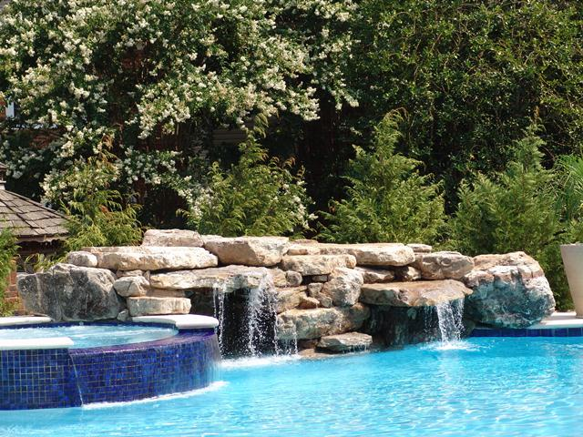 Creative Garden Spaces Inc, Brassfield, Greensboro NC, pool waterfall, natural waterfall, water feature, pool fountain, landscape boulders, custom stonework
