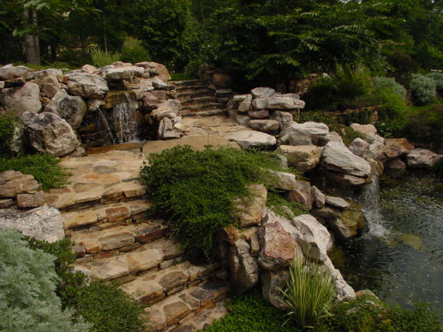 Creative Garden Spaces Inc, Chapel Hill NC, water feature, natural waterfall, water garden, koi pond, stone steps, custom stonework, natural stone stairway, landscape boulders